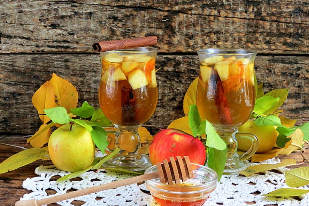 An apple gives tea a special aroma and a drop of honey gives a spicy taste